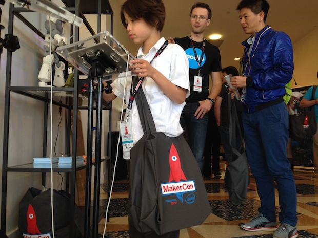A MakerCon attendee checks out an interactive toy display.