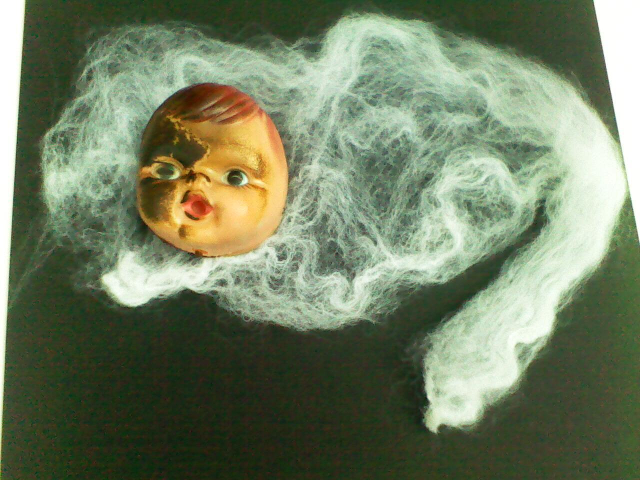 WebHeads! Create Spiderweb-Trapped Doll Heads for Halloween